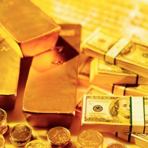 Fysiskt guld och papperspengar som går att trycka