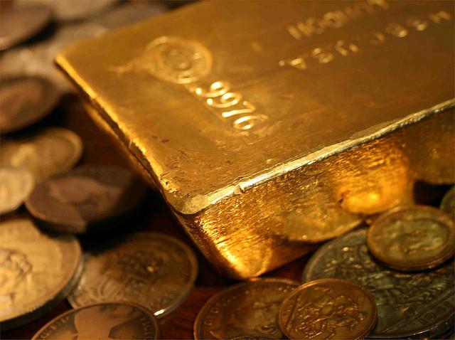Guldtacka på guldmynt