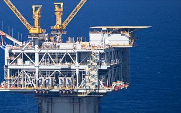 Nu ska du köpa världens största oljebolag med bra utdelning